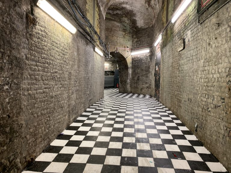 house of vans london corridor underground venue party checkered floor londres uk