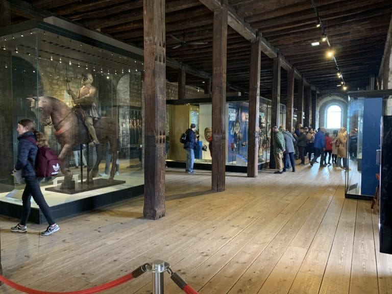 inside the white tower large wooden room with knight on horse tower of london united kingdom londres